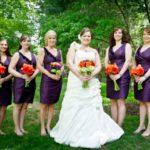 dark purple bridesmaid dresses with orange bouquets