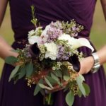 dark purple bridesmaid dresses with white flowers
