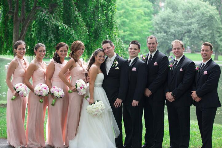pale pink bridesmaid dresses and black suits